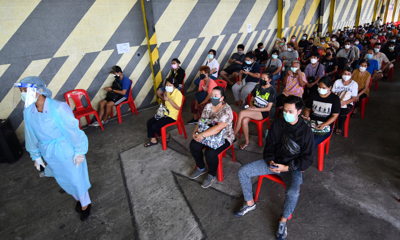 Residents of the Klong Toey area, a neighbourhood with a recent rise in coronavirus cases, wait to receive Sinovac Covid-19 and the AstraZeneca vaccines in Bangkok, Thailand on Monday. — AP