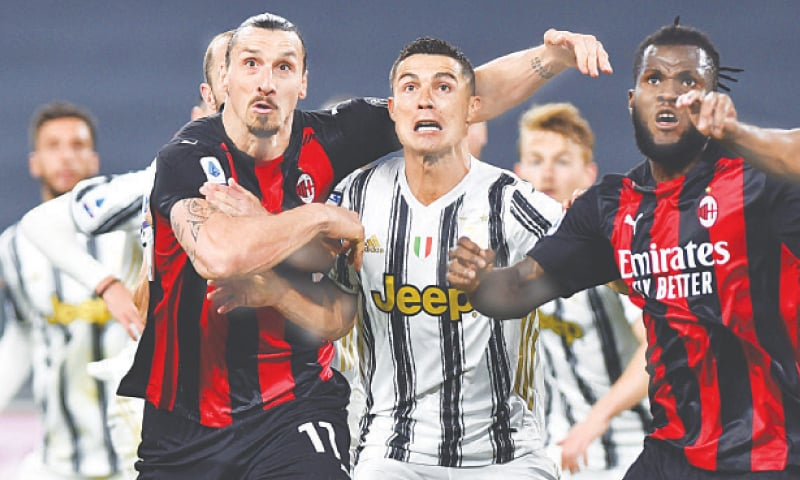 TURIN: AC Milan's Zlatan Ibrahimovic (L) and Juventus' Cristiano Ronaldo in action during their Serie A match at the Allianz Stadium.—Reuters