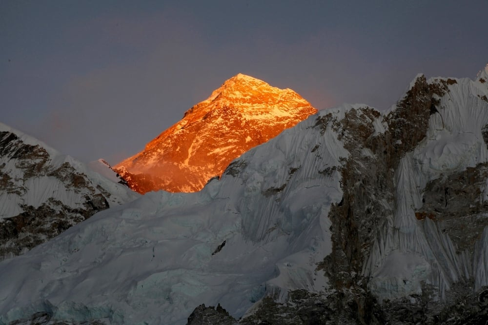Mount Everest straddles the China-Nepal border, with the north slope belonging to China. — AP