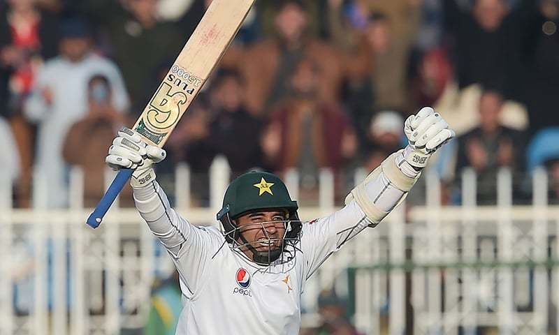 Pakistan's Abid Ali celebrates after scoring a century (100 runs) during the fifth and final day of the first Test cricket match between Pakistan and Sri Lanka at the Rawalpindi Cricket Stadium in Rawalpindi on December 15, 2019. — AFP