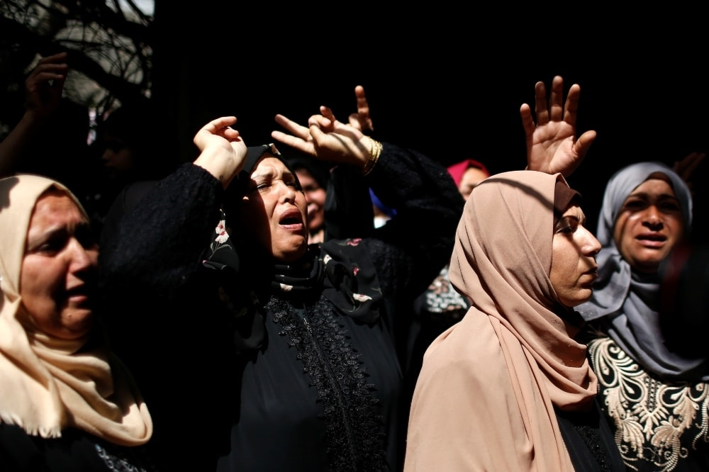 Relatives of Palestinian man Ahmed Al-Shenbari, who was killed amid a flare-up of Israeli-Palestinian violence, react during his funeral in the northern Gaza Strip on May 11. — Reuters
