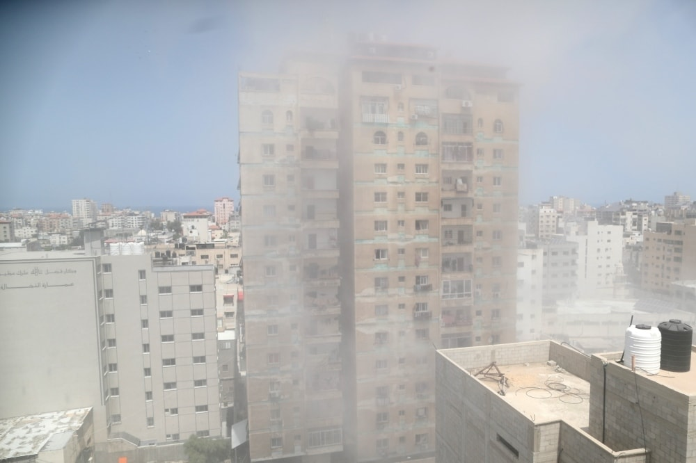 Dust and smoke rise following an Israeli air strike amid a flare-up of Israeli-Palestinian violence, in Gaza City on May 11. — Reuters