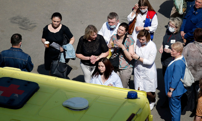 A woman cries as she is taken to an ambulance at the scene of a shooting at School No. 175 in Kazan, the capital of Russia's republic of Tatarstan, on Tuesday. — AFP