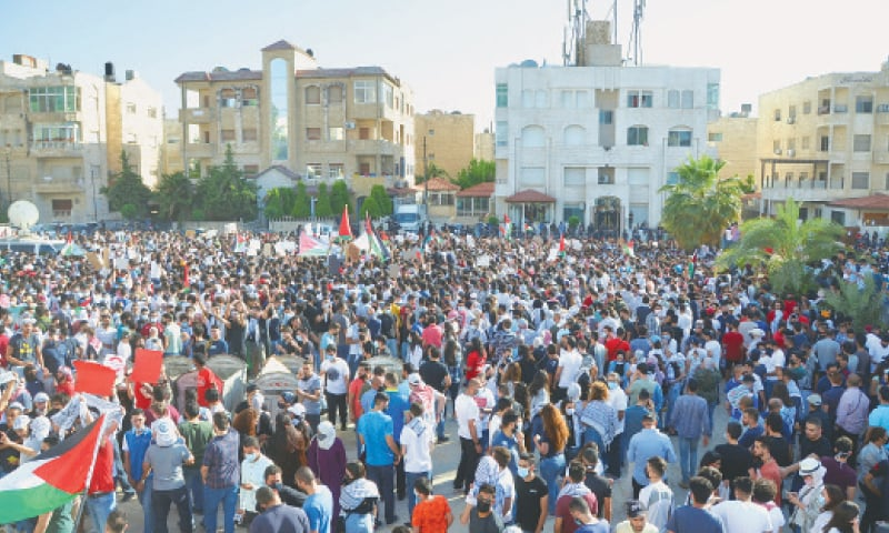 Amman: Jordanians demonstrate near the Israeli embassy on Tuesday to express solidarity with Palestinians.—Reuters
