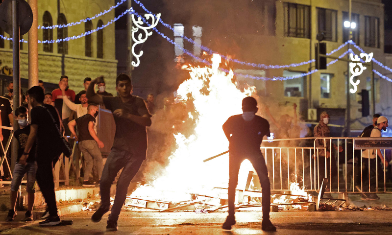 Palestinian protesters hurl stones at Israeli security forces in Jerusalem's Old City. — AFP/File