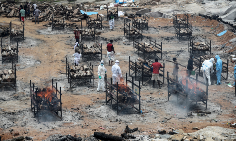 Bodies of people who died of Covid-19 are cremated at an open crematorium on the outskirts of Bengaluru, Karnataka state, India on Wednesday. — AP