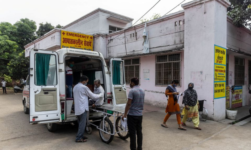 Relatives help Jagdish Singh, 57, out of an ambulance outside a government-run hospital to receive treatment, amidst the coronavirus, in Bijnor district, Uttar Pradesh, India on Tuesday. — Reuters