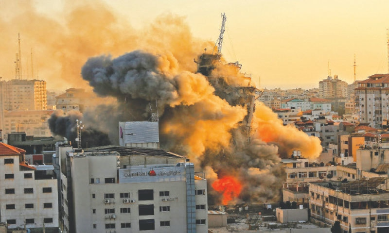 GAZA CITY: Heavy smoke and fire rise from Al-Sharouk tower as it collapses after being hit during an Israeli air raid.—AFP