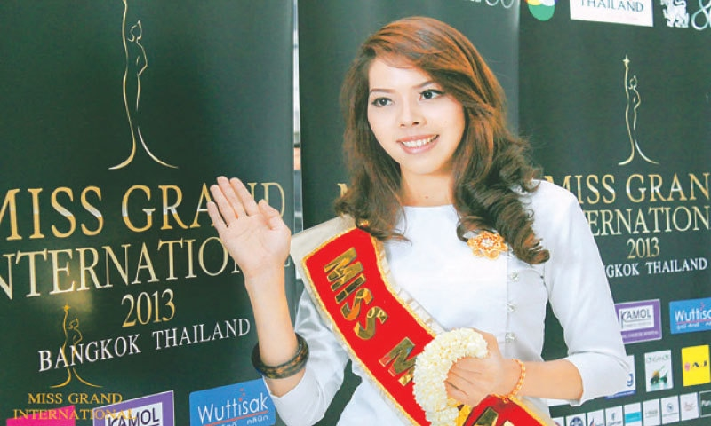 This handout photo from the Miss Grand International beauty pageant, taken in Aug 2013 and released on Wednesday, shows Myanmar contestant Htar Htet Htet waving during the competition in Bangkok.—AFP