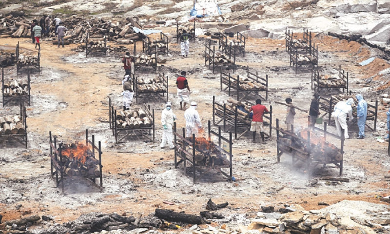 BODIES of Covid-19 victims are being cremated at an open crematorium on the outskirts of Bengaluru, Karnataka state—AP