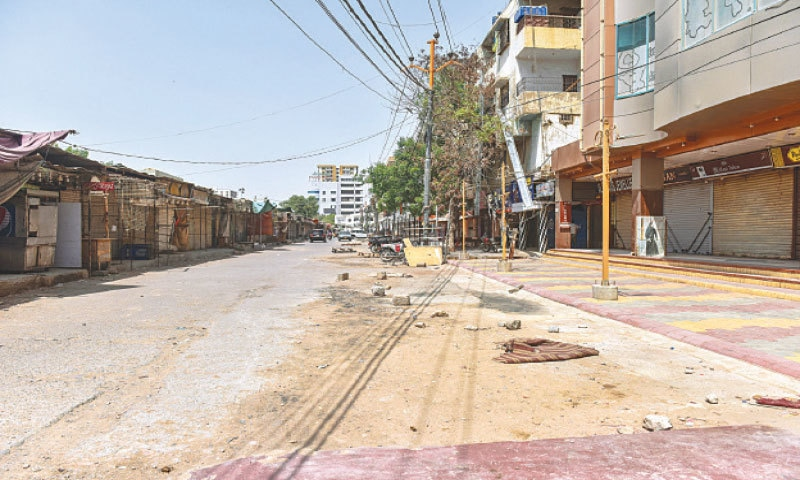 ONCE bustling markets and other public spaces have turned to ghost towns during the lockdown, as seen here in North Nazimabad's Hyderi area.—Fahim Siddiqi/White Star