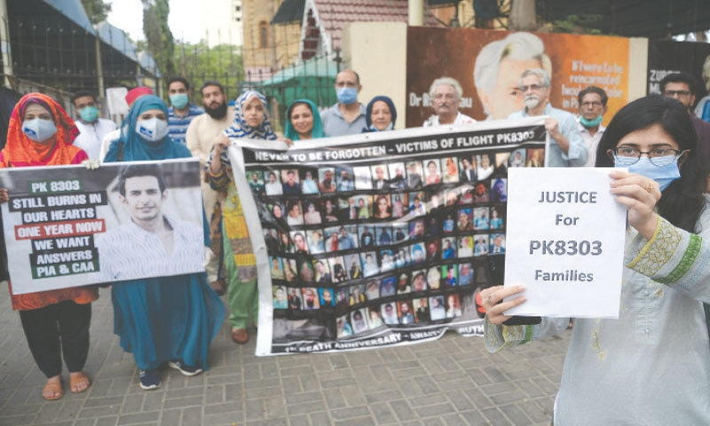 RELATIVES of the crash victims protest outside the press club on Wednesday.—Shakil Adil/White Star