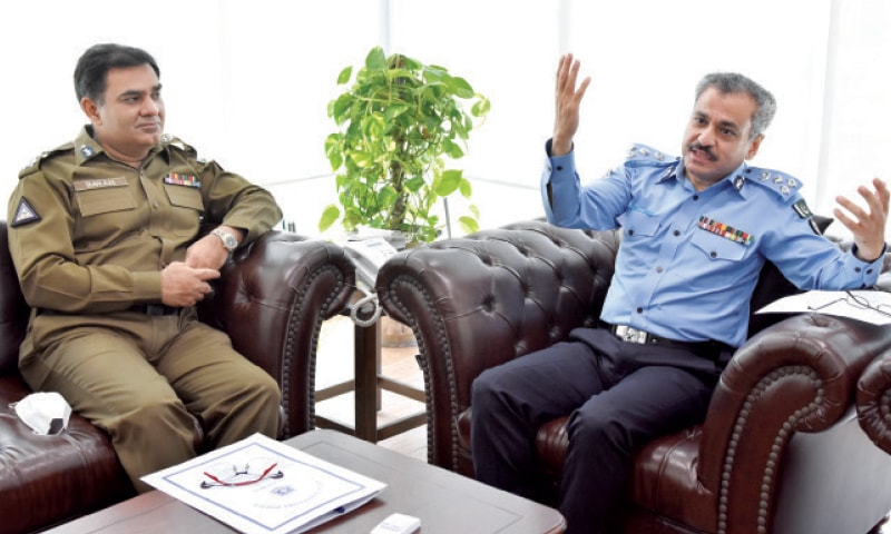 IGP Qazi Jamilur Rehman gestures as he speaks to Dawn at his office in Islamabad on Wednesday. RPO Rawalpindi Imran Ahmer is also present. — White Star