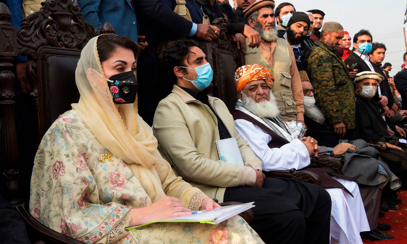In this file photo, PML-N vice president Maryam Nawaz, PPP chairperson Bilawal Bhutto-Zardari and JUI-F chief Maulana Fazlur Rehman attend a PDM rally in Peshawar. — AFP/File