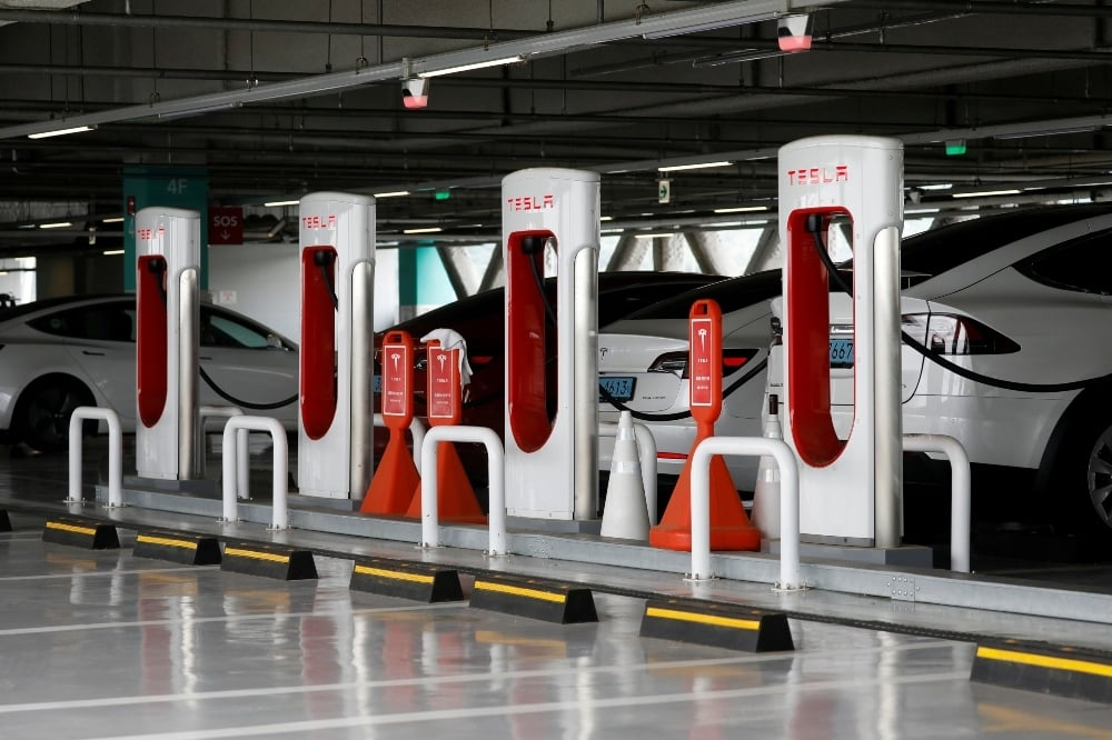 Tesla electric vehicles are charged at a Tesla Supercharger charging station in Hanam, South Korea. — Reuters