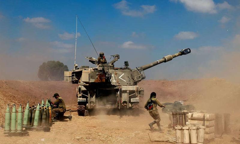 اسرائیل نے غزہ کی سرحد کے ساتھ جنگی فوج تیار کرلی ہے - فوٹو:رائٹرز