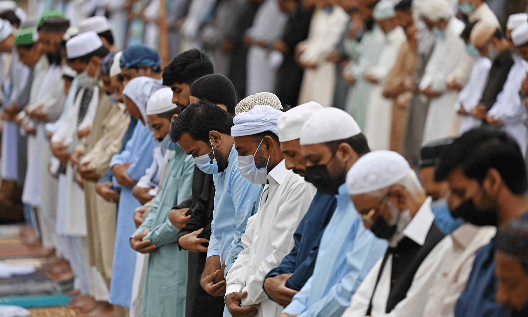 Muslims offer prayers on the occasion of Eidul Fitr that marks the end of the holy month of Ramazan at Eidgah Sharif in Rawalpindi on Thursday. — AFP