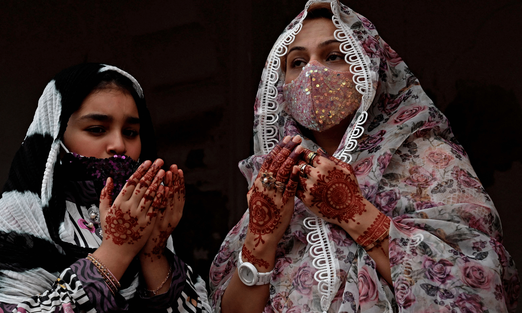Pakistani women offer special prayers on Eidul Fitr at the historic Badshahi Mosque in Lahore. — AFP