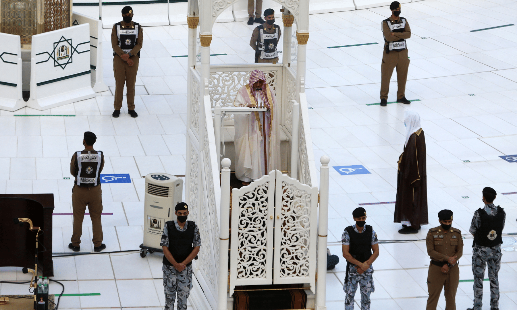 Security forces stand guard as Muslim worshippers perform the Eidul Fitr prayer at the Grand Mosque in Saudi Arabia's Makkah. — AFP