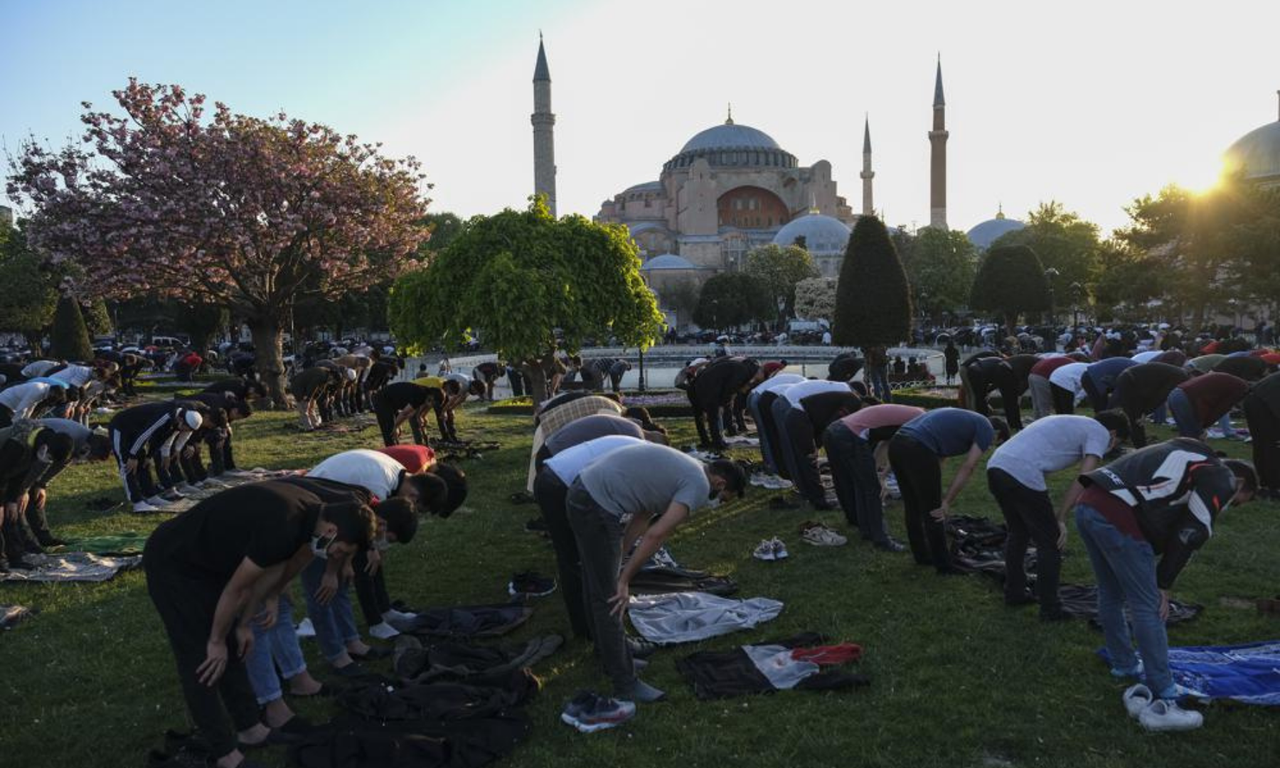 Muslims offer prayers during the first day of Eidul Fitr outside the Byzantine-era Hagia Sophia mosque in the historic Sultanahmet district of Istanbul. — AP