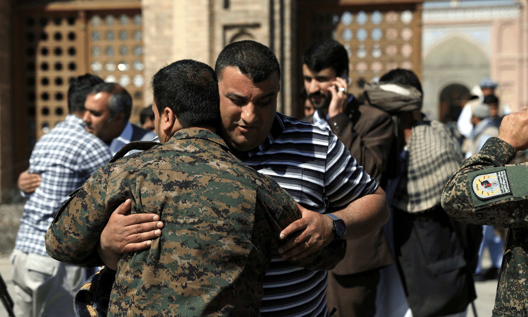 Men hug each other after offering Eidul Fitr prayers at a mosque in Kabul, Afghanistan. — AP