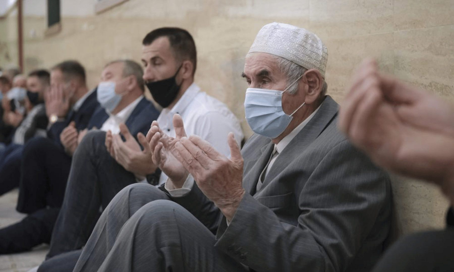 Bosnian Muslims, wearing face masks to protect themselves from Covid-19, attend Eidul Fitr prayers in Konjic, Bosnia. — AP