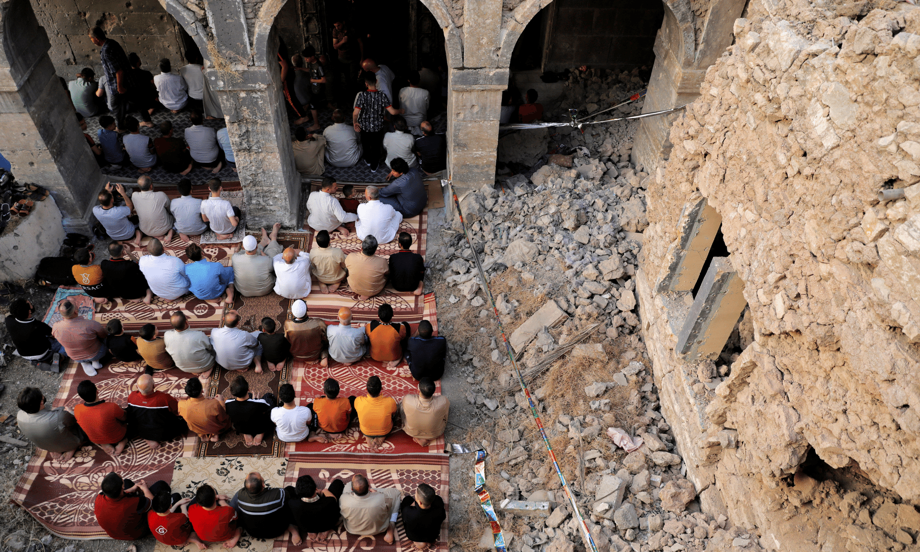 People attend Eidul Fitr prayer marking the end of the holy fasting month of Ramazan, at the oldest Al-Masfi mosque, which was damaged during the war against Islamic State militants in Mosul, Iraq. — Reuters
