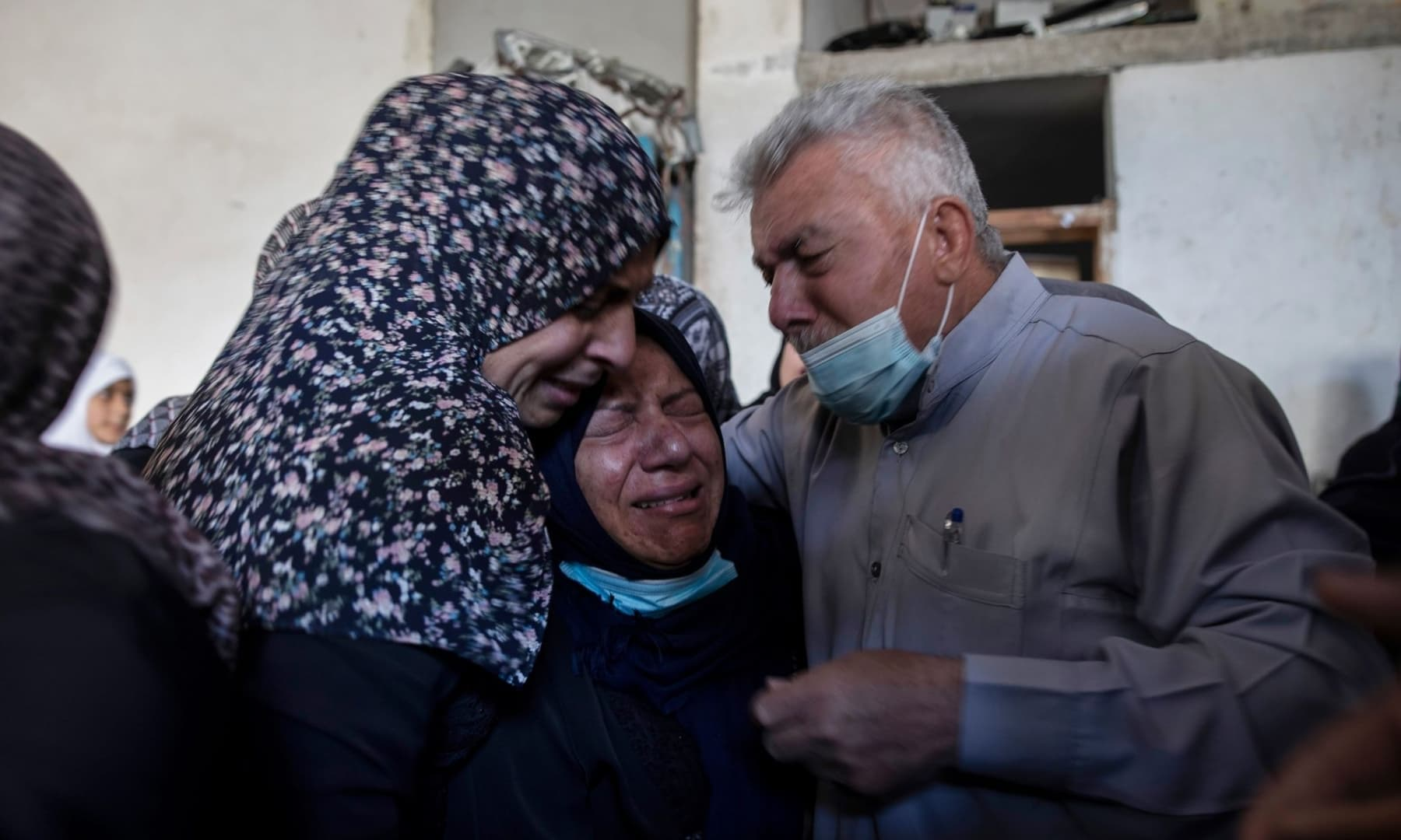 Palestinian relatives mourn over the bodies of four brothers from the Al-tanani family that were found under the rubble of a destroyed house following Israeli airstrikes in Beit Lahiya, northern Gaza Strip, May 14, 2021. — AP