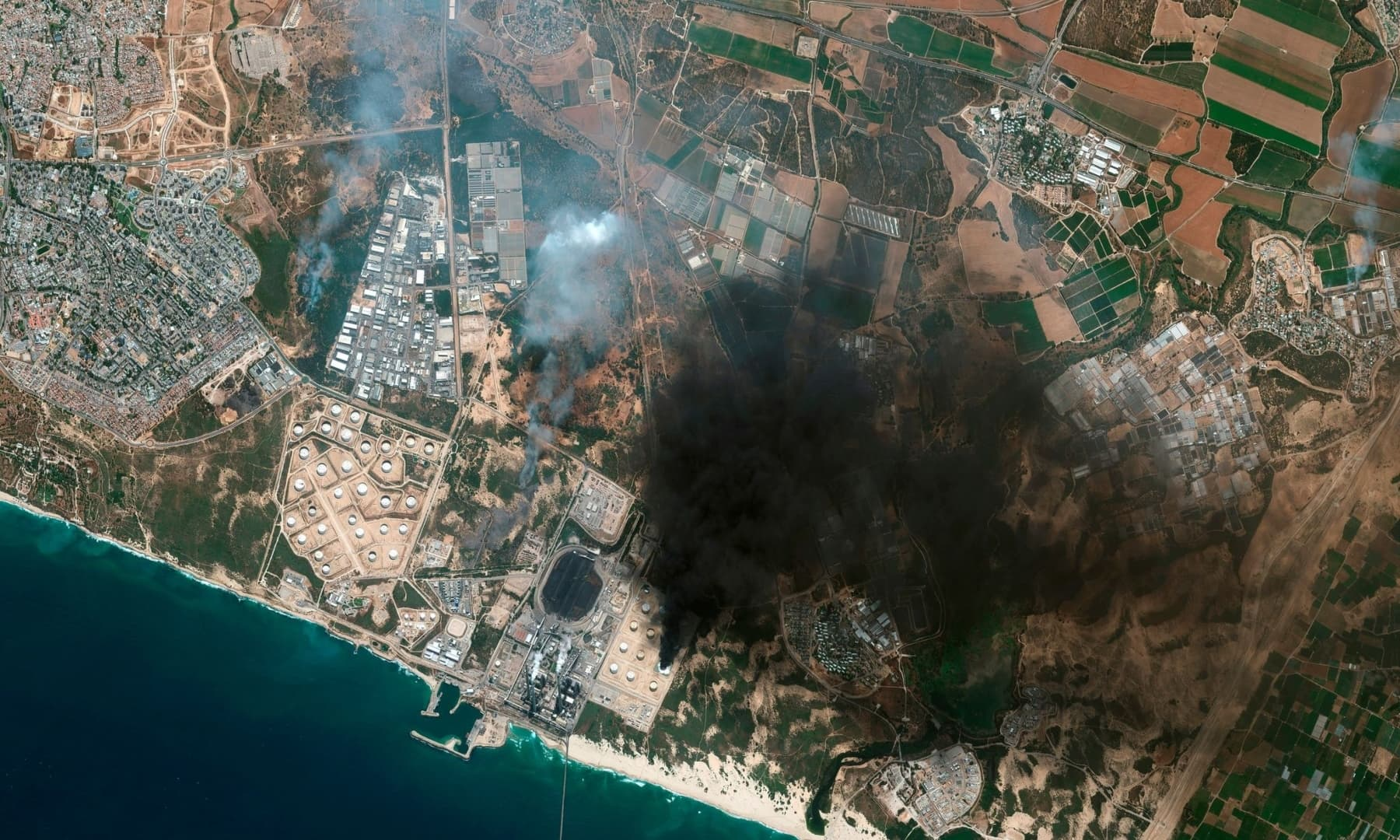 This satellite image provided by Maxar Technologies shows a fire at an oil tank farm in Ashkelon, Israel, May 12, 2021. — AP