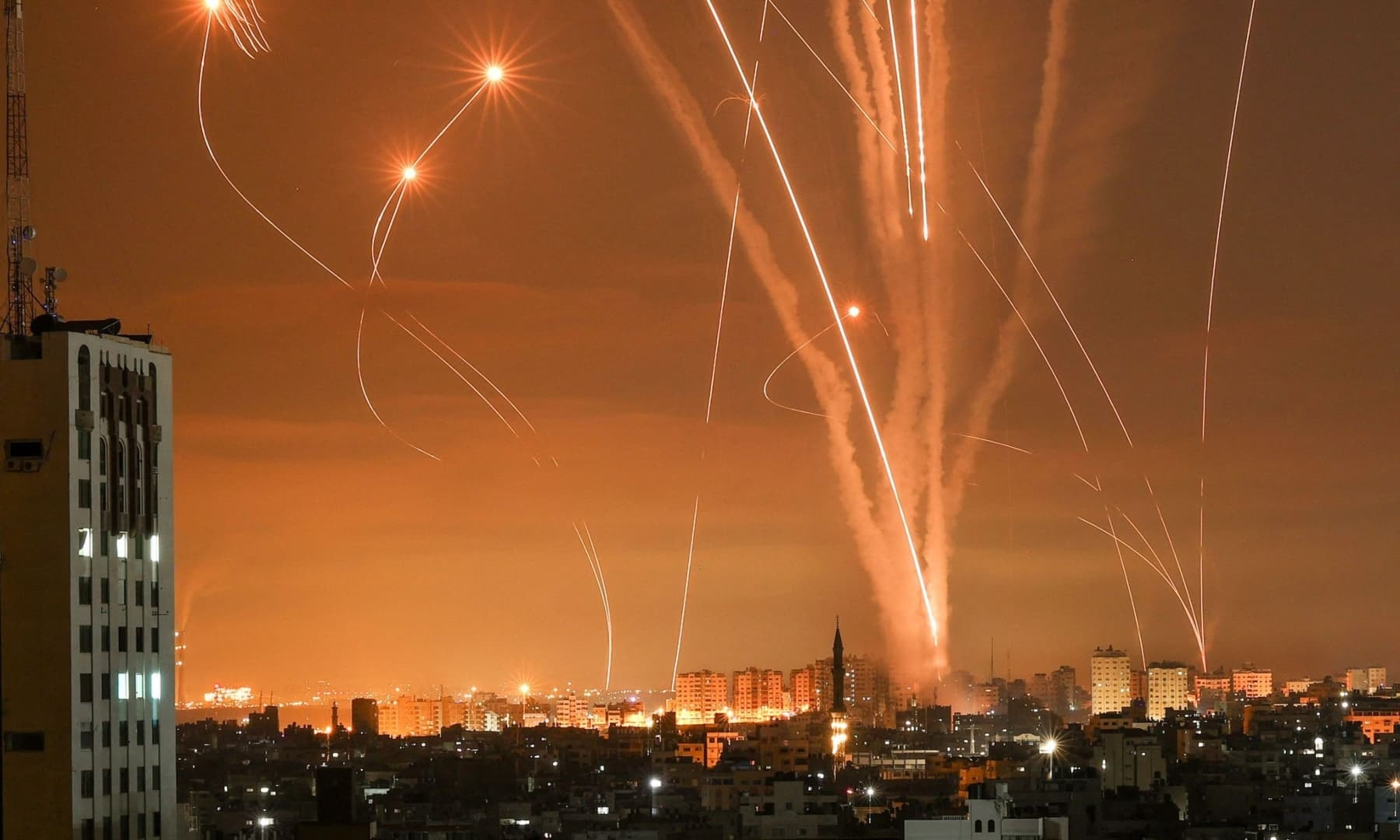 Rockets light up the night sky as they are fired towards Israel from Beit Lahia in the northern Gaza Strip, May 14, 2021. — AFP