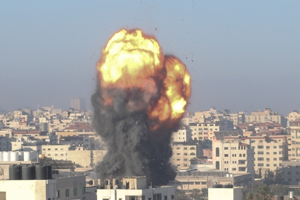 A fireball and smoke billow up into the air during an Israeli airstrike on Gaza City targeting the Ansar compound in the Gaza Strip early on May 15. — AFP