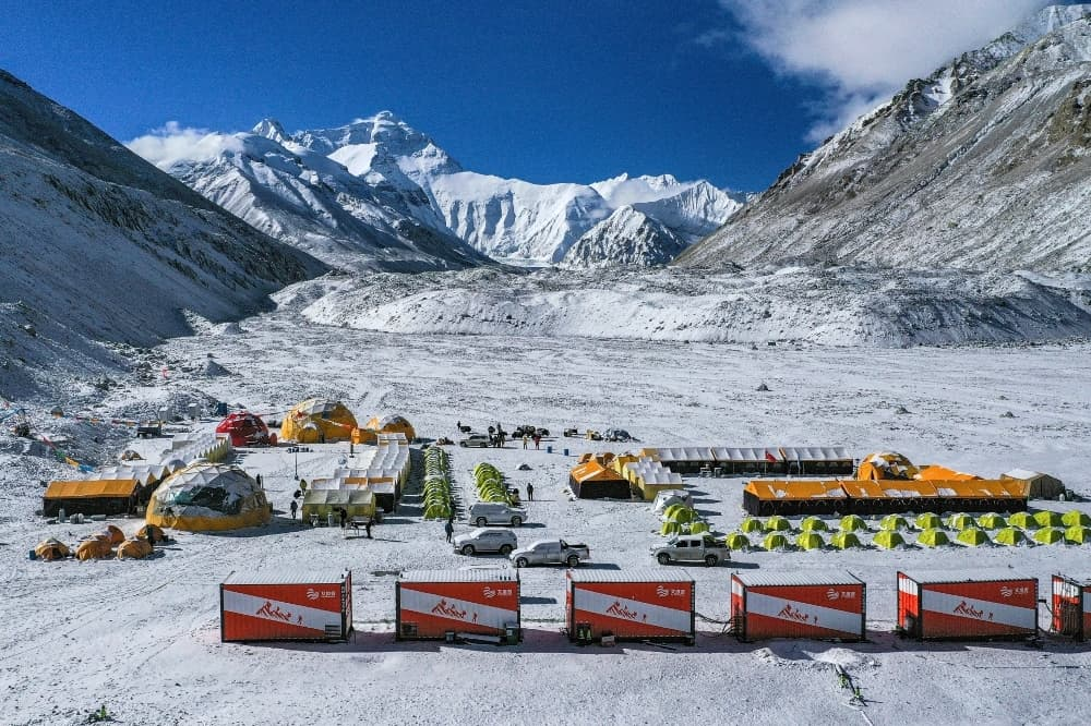 In this file photo released by China's Xinhua News Agency, vehicles and tents are seen at the base camp at the foot of the Chinese side of the peak of Mount Everest. — AP