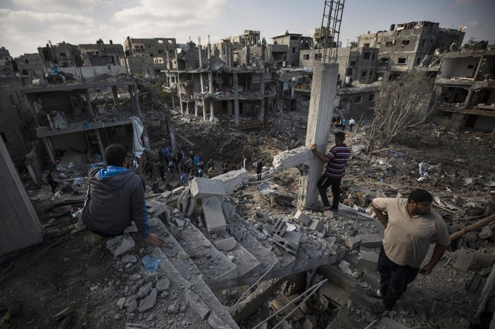Palestinians inspect their destroyed houses following overnight Israeli airstrikes in town of Beit Hanoun on May 14. — AP