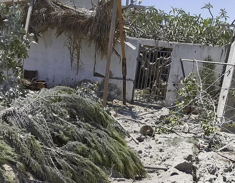 Debris from an Israeli airstrike scatters the family farm of Associated Press journalist Fares Akram on Friday in the northern Gaza Strip. — AP