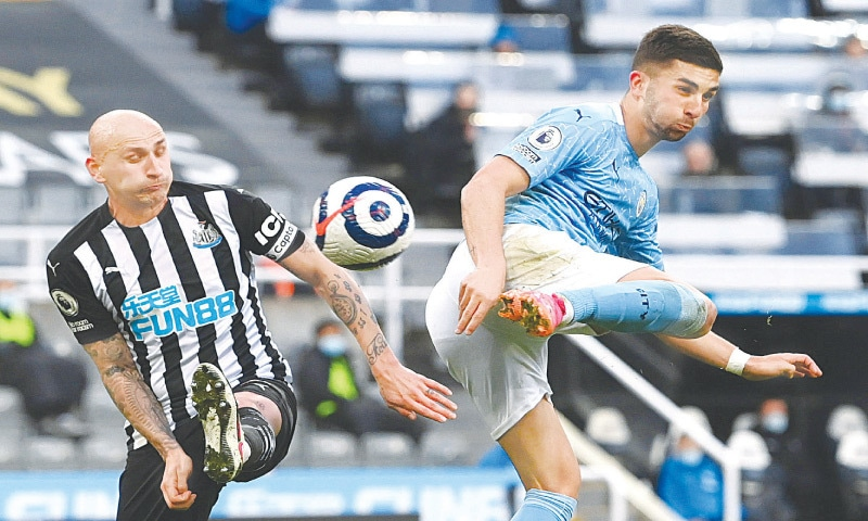 NEWCASTLE: Manchester City's Ferran Torres (R) scores against Newcastle United during their English Premier League match at St James' Park.—Reuters