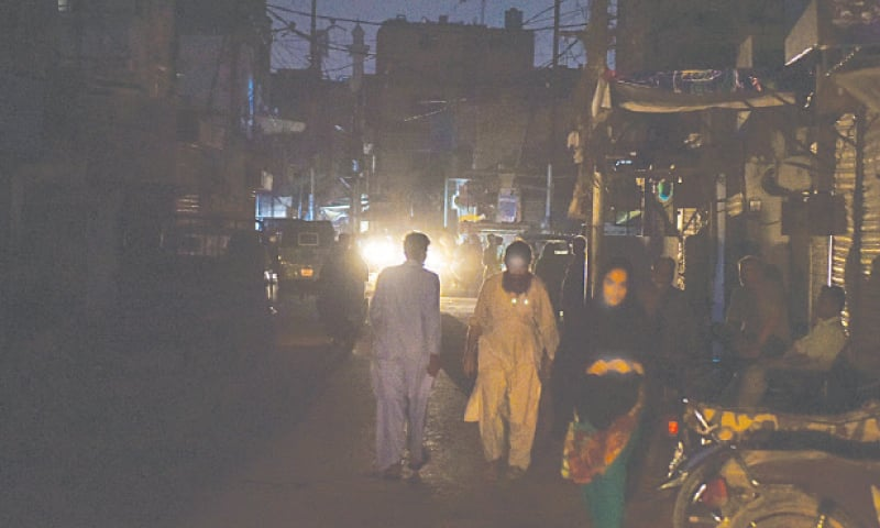 Densely populated Lines Area plunges into darkness as the K-Electric routinely carries out loadshedding for over two hours three times a day.—Fahim Siddiqi/White Star
