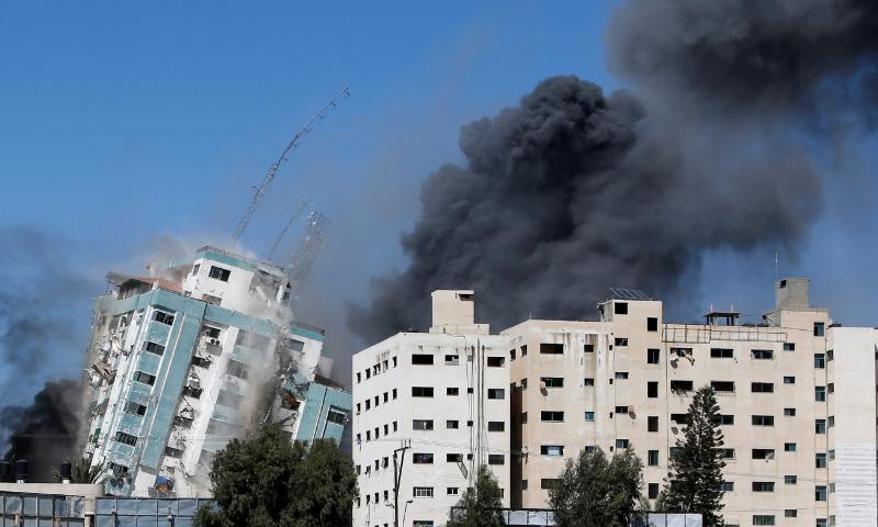 Gaza tower housing AP, Al Jazeera collapses after Israeli missile strike in Gaza City on Saturday. — Reuters
