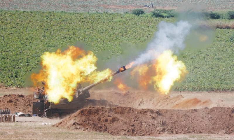 Israeli soldiers fire a 155mm self-propelled howitzer towards Gaza Strip from their positions. — AFP