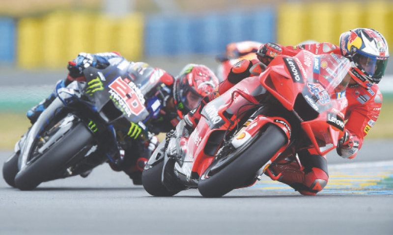 LE MANS: Ducati Team's Jack Miller steers his bike ahead of Monster Energy Yamaha's Fabio Quartararo during the French Moto GP on Sunday.—AFP
