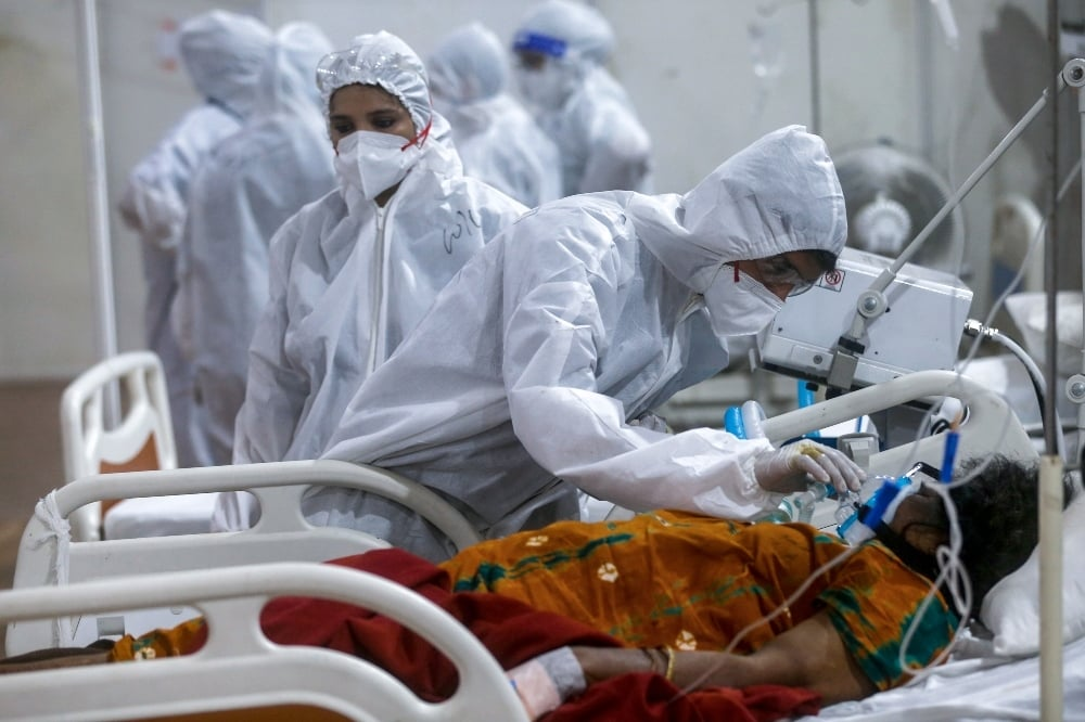In this file photo, a health worker tries to adjust the oxygen mask of a patient at the BKC jumbo field hospital, one of the largest Covid-19 facilities in Mumbai. — AP