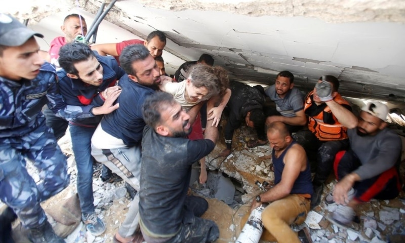 Rescuers carry Suzy Eshkuntana, 6, as they pull her from the rubble of a building at the site of Israeli air strikes, in Gaza City, May 16. — Reuters
