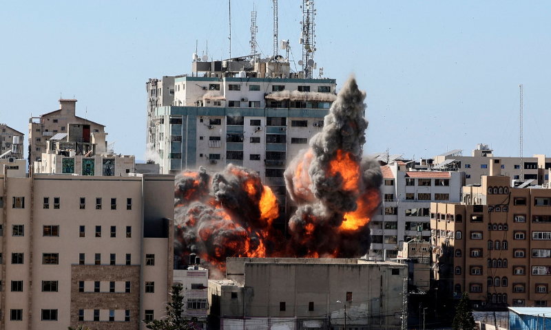 A ball of fire erupts from the Jala Tower as it is destroyed in an Israeli airstrike in Gaza City on Saturday. — AFP