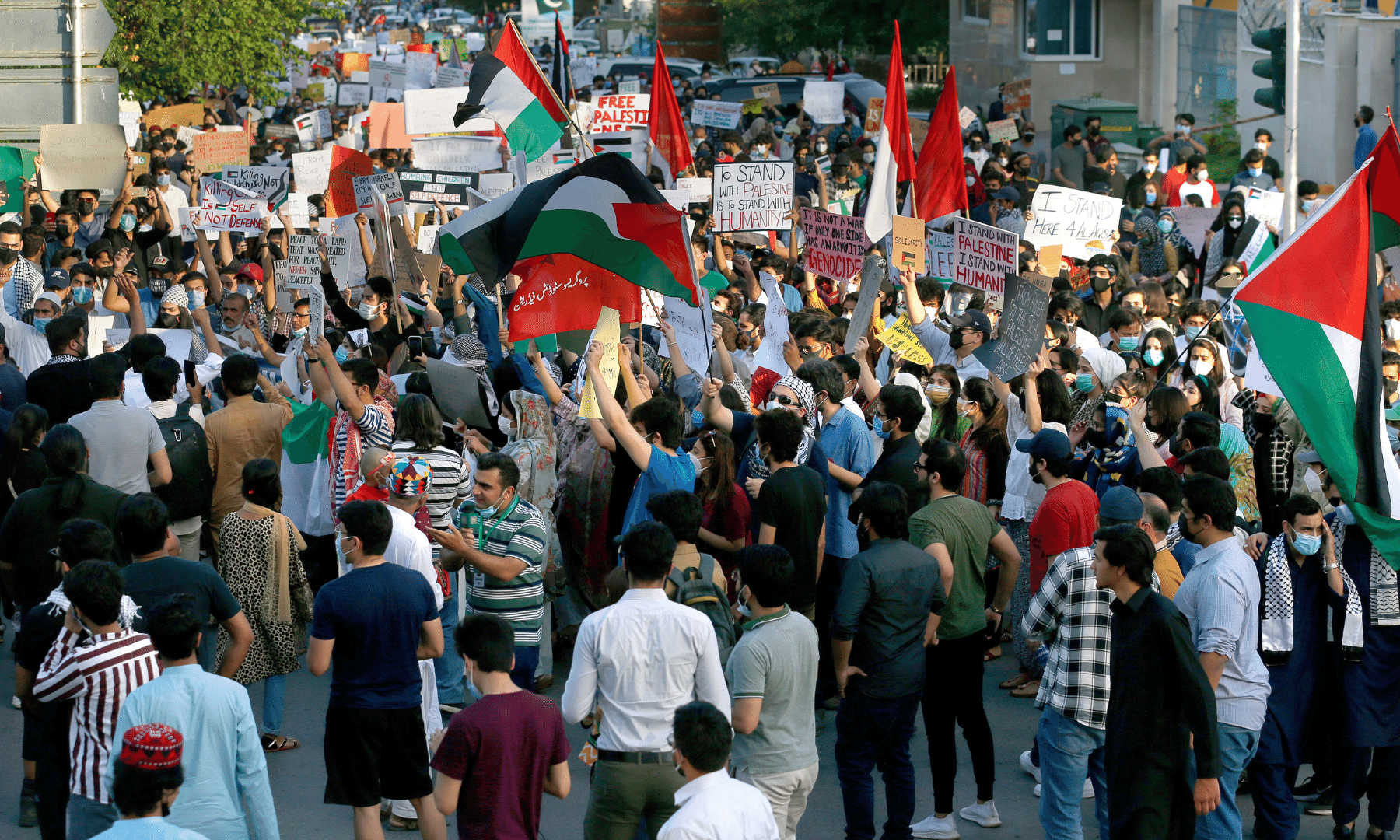 People take part in a rally in support of Palestinians organised by civil society organisations, in Islamabad on Monday. — AP