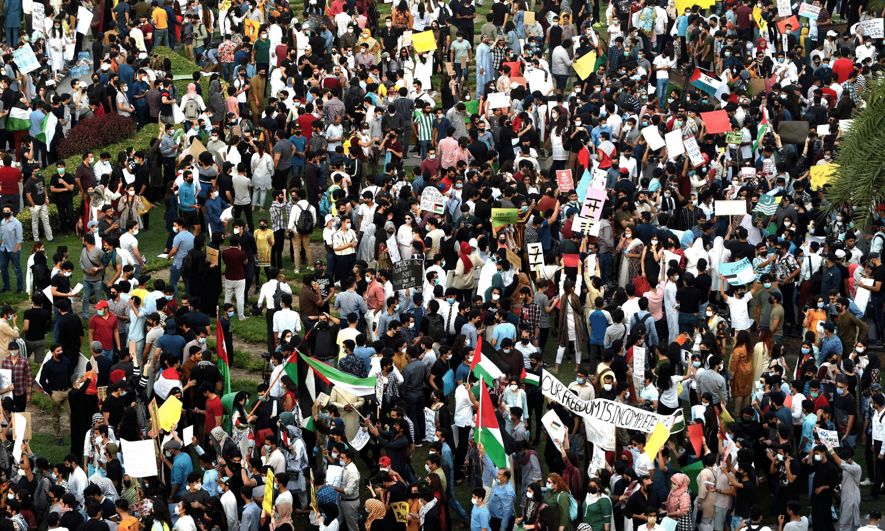 Protesters hold placards as they take part in a demonstration in support of Palestine during an anti-Israel protest rally in Lahore on Monday. — AFP