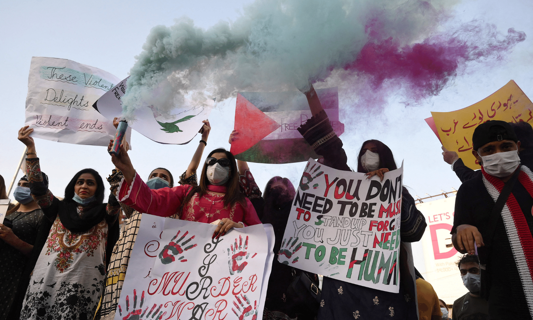 Protesters hold placards as they take part in a demonstration in support of Palestine in Lahore. — AFP