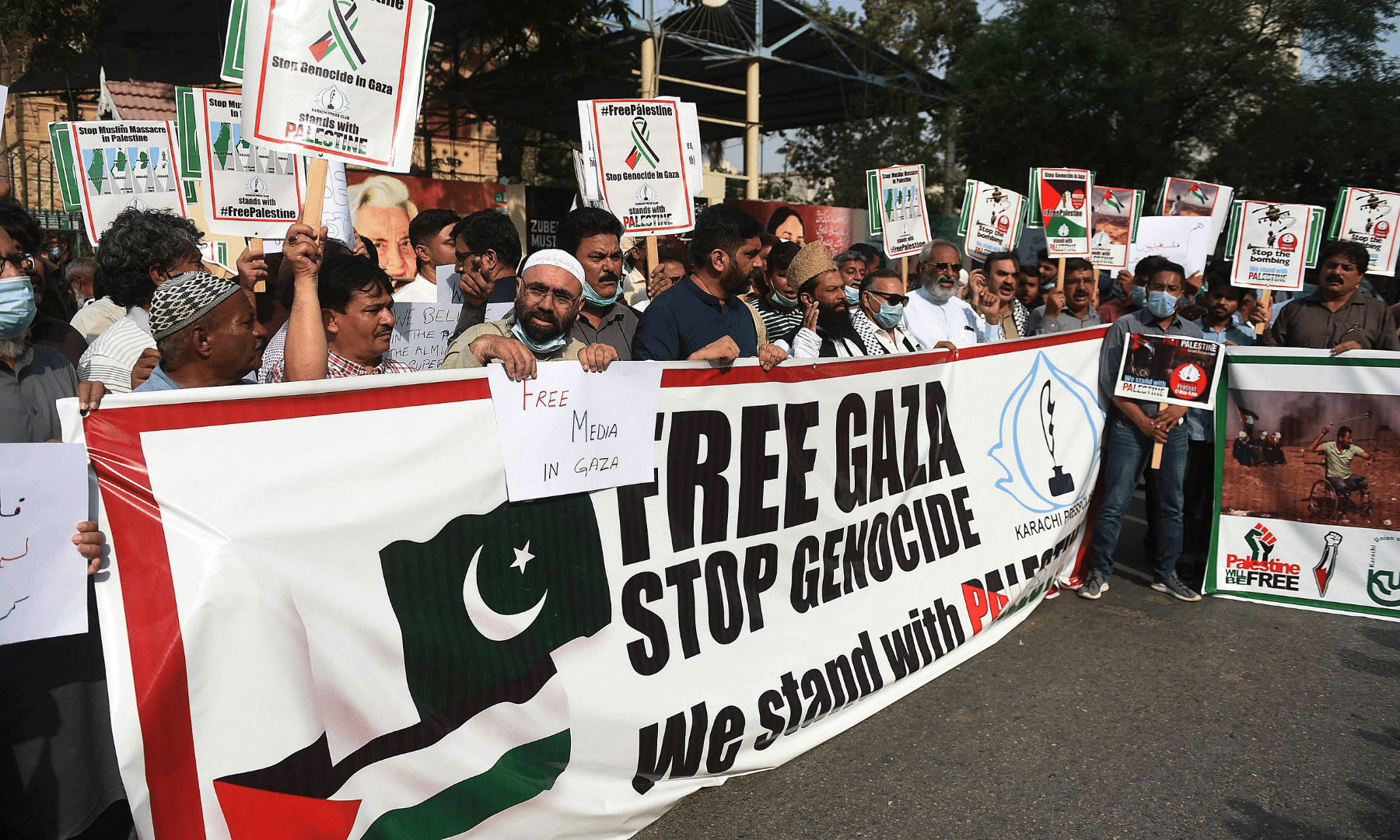Journalists shout slogans as they take part in a demonstration in support of Palestine in Karachi. — AFP
