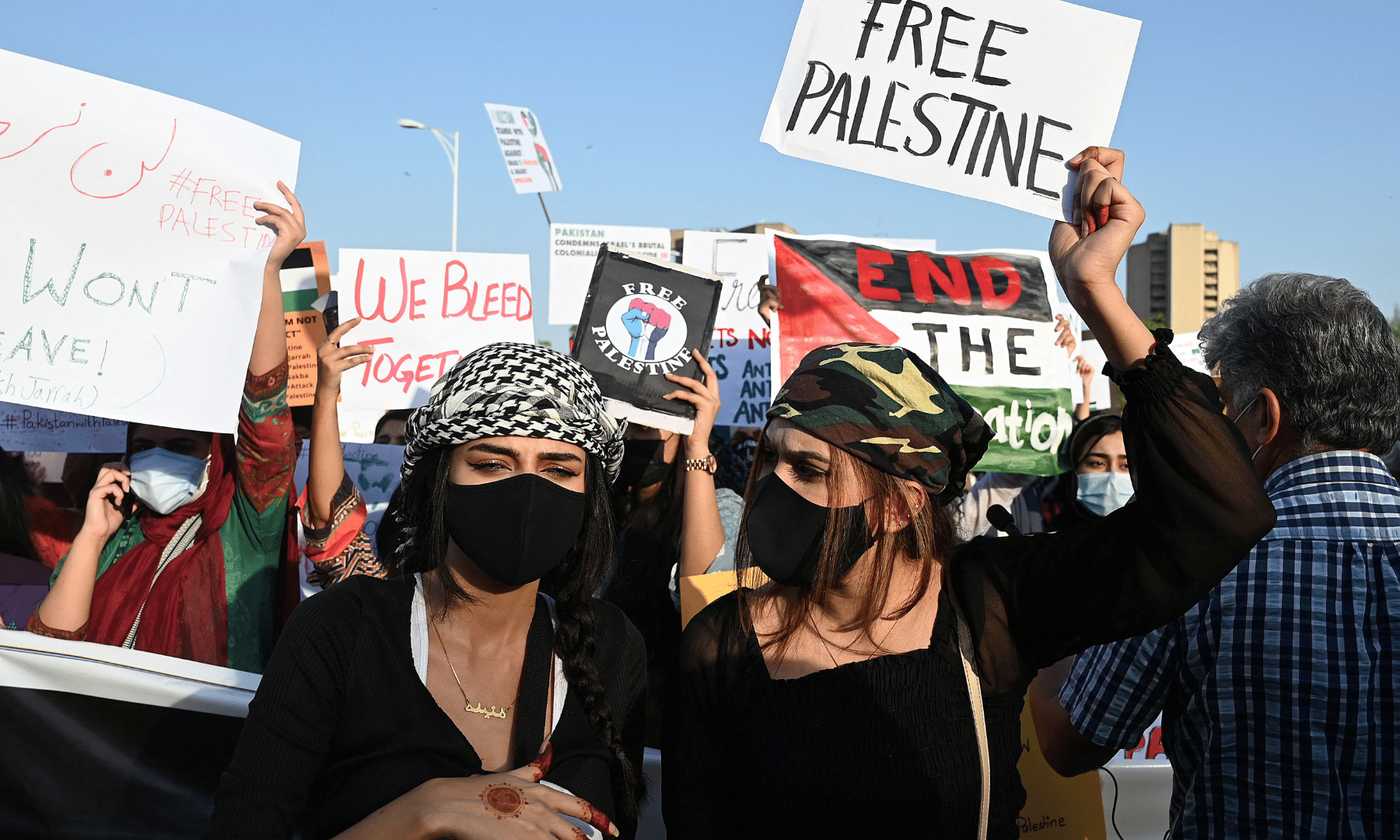 Protesters carry placards and chant slogans as they take part in a demonstration in support of Palestine during an anti-Israel protest rally in Islamabad. — AFP