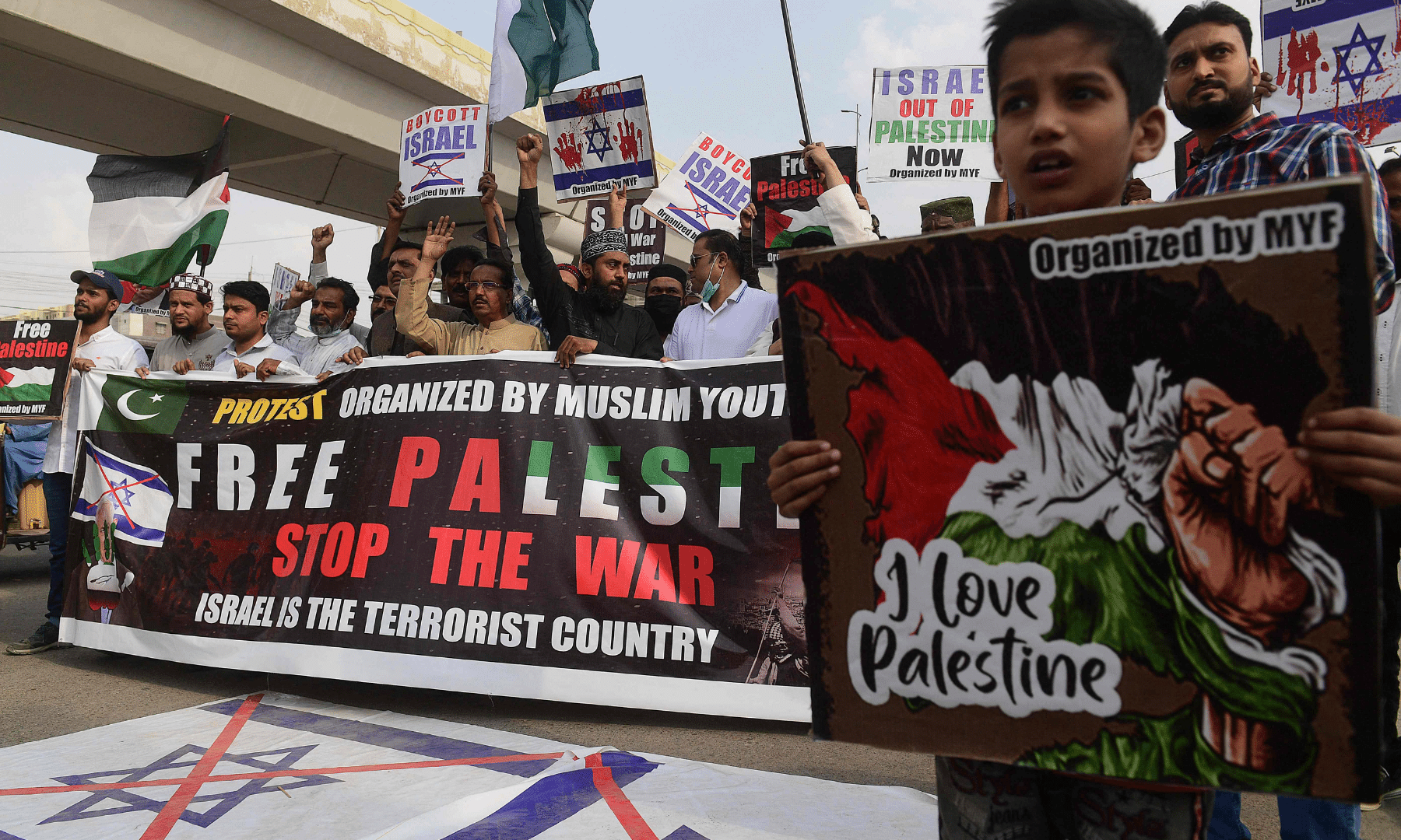 Protesters hold placards as they take part in a demonstration in support of Palestine in Karachi. — AFP