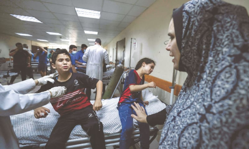 MEMBERS of a Palestinian family cry at a hospital after the death of family members in an Israeli air strike on their home in Gaza City on Monday.—AFP