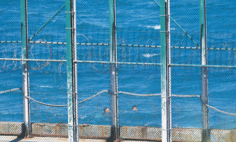 CEUTA: Migrants swim to the Spanish enclave of Ceuta from neighbouring Morocco on Monday.—AFP